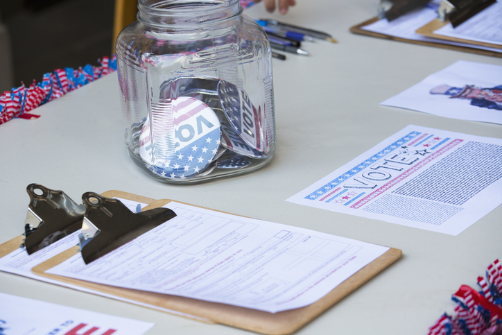 voting table with clipboard and voter buttons in a jar