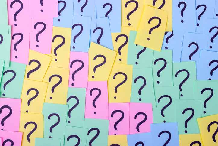 Question marks on post its that are pink, yellow, and blue