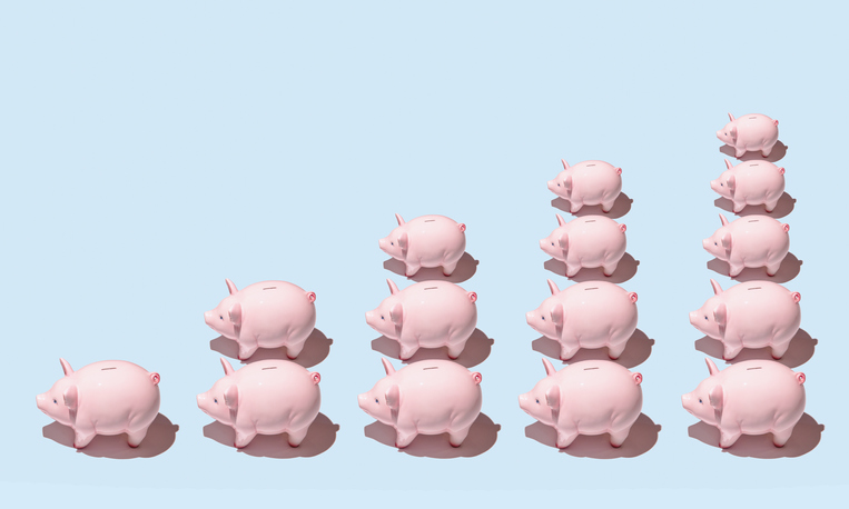 Multiple piggy banks align to form chart