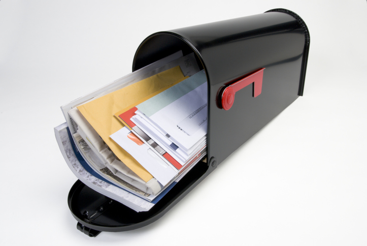 Black mail box open with mail stack showing