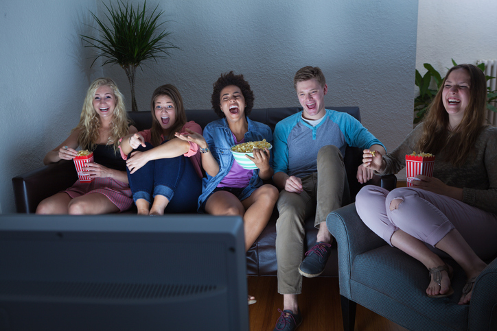 Group of people watch TV