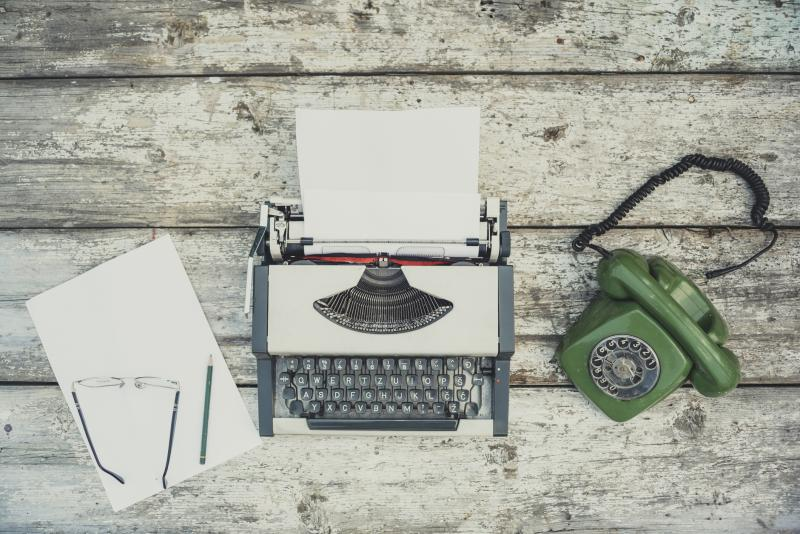 typewriter with a green phone paper and pencil GOTV Script