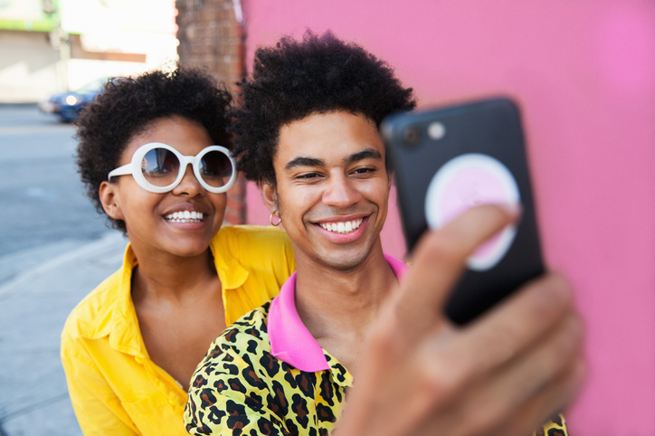 Young folks using social media on a cell phone