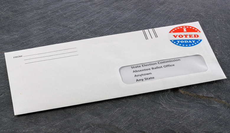 Absentee ballot in envelope