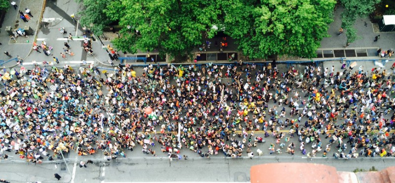 Overhead view of crowd marching in street