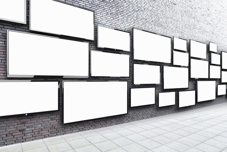 Blank tvs up on a wall