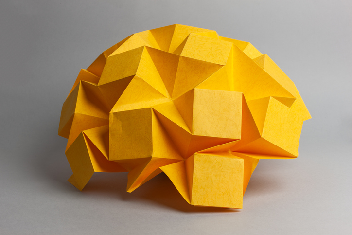 Brain made out of yellow paper