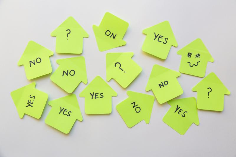 "Neon green sticky notes with words, ""yes"" and ""no"" on them to symbolize the importance of prioritizing when running a political campaign"